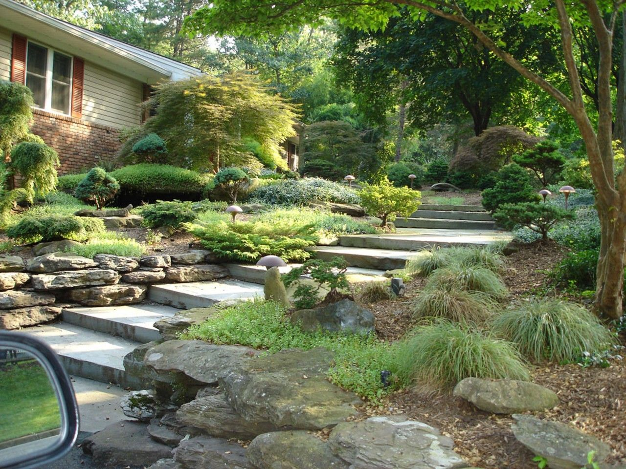 Astounding home landscaping ideas decor fetching small for Stone landscaping ideas