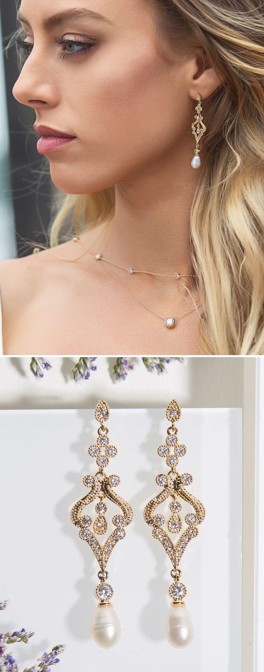 Bride is wearing gold pearl drop earrings