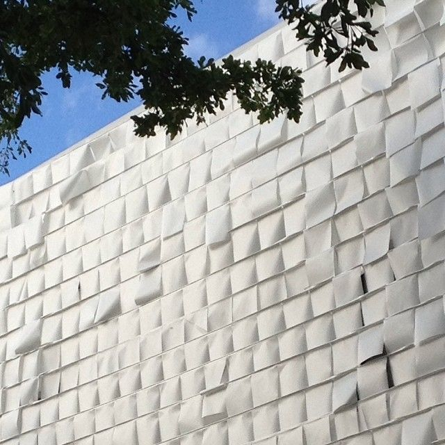 newbuilding #wynwoodmiami #luispons #byluisponsdesignlab The facade is covered with small white flags to create whimsical and kinetic graffiti. With the wind flags moving on the surface, creating wonderful designs, while the natural light reflecting magical effects.