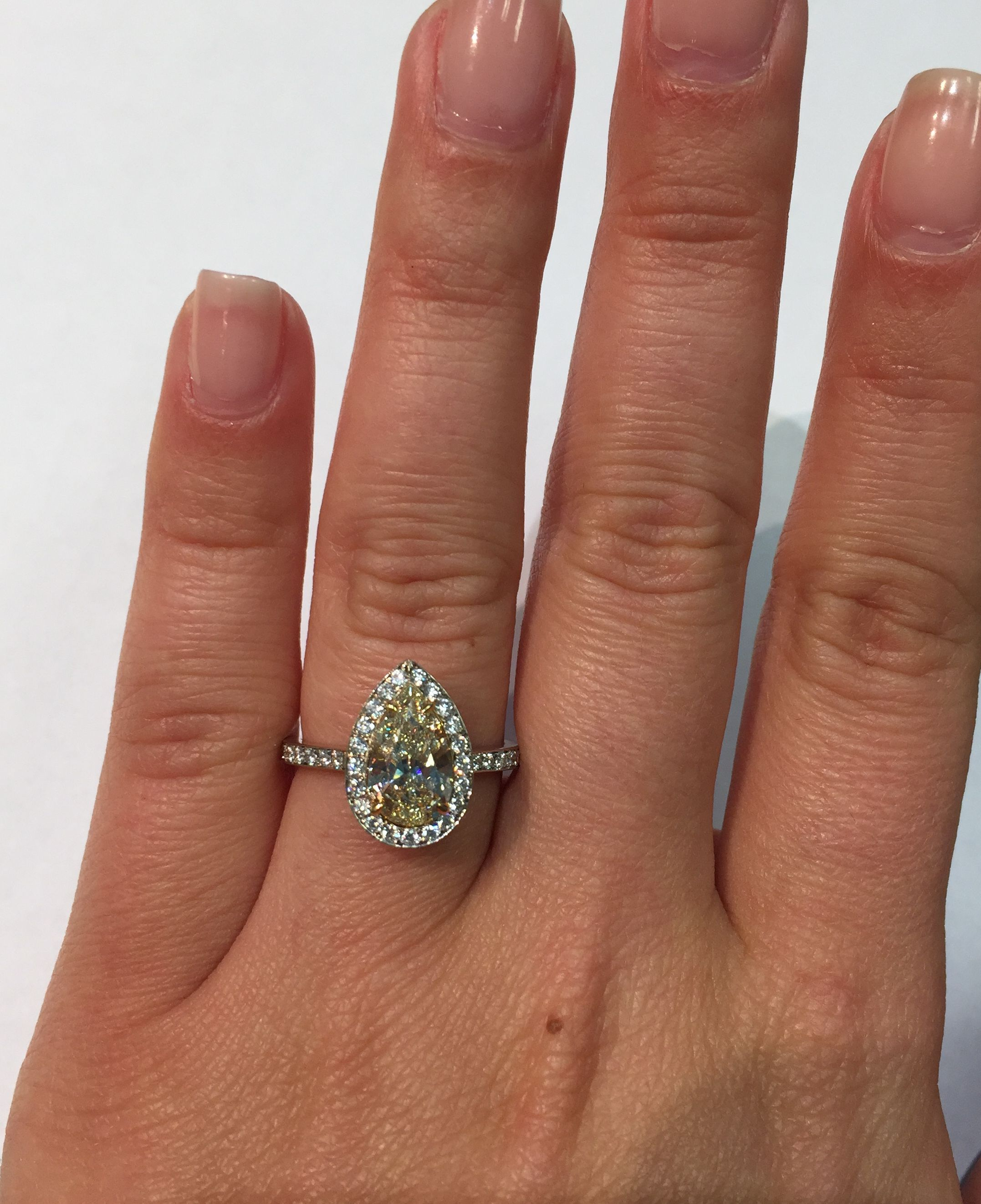 Pear shaped yellow diamond halo engagement ring amazing for a