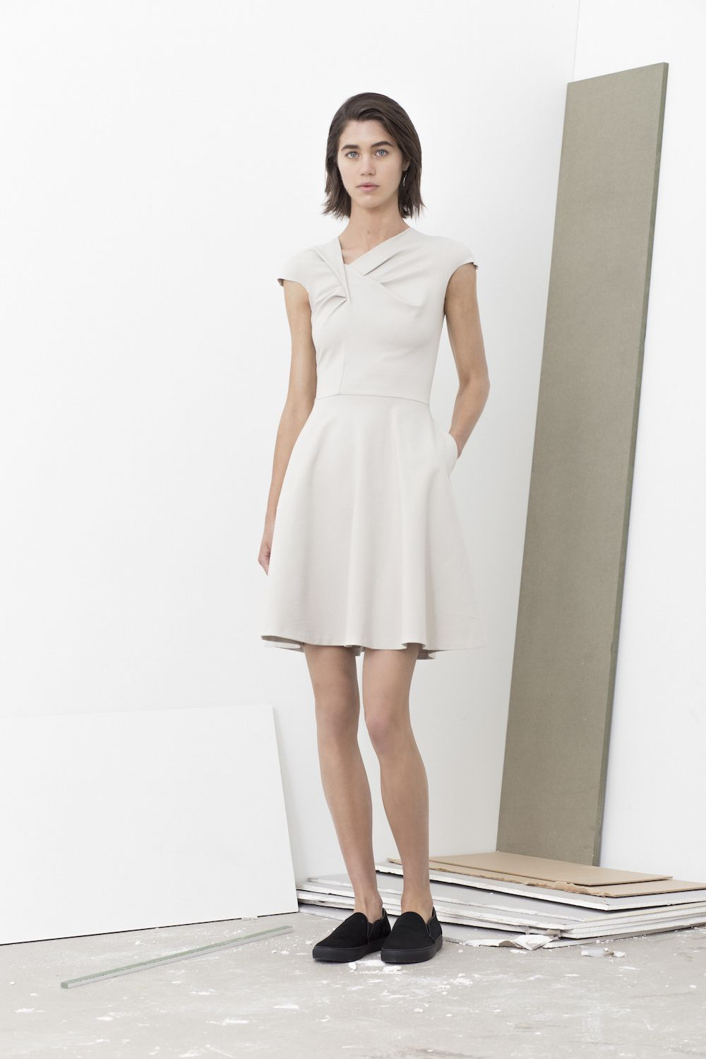 Zach twisted front dress with flair hem and seam pockets