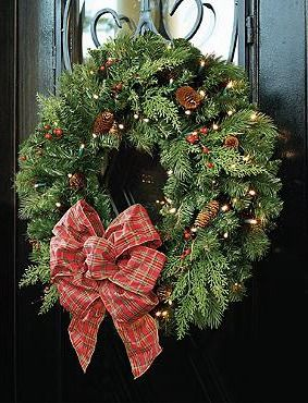 Adorn your door with classic Christmas beauty with the Winter Pine Cordless Wreath that features bright LED lights and stunning winter foliage.