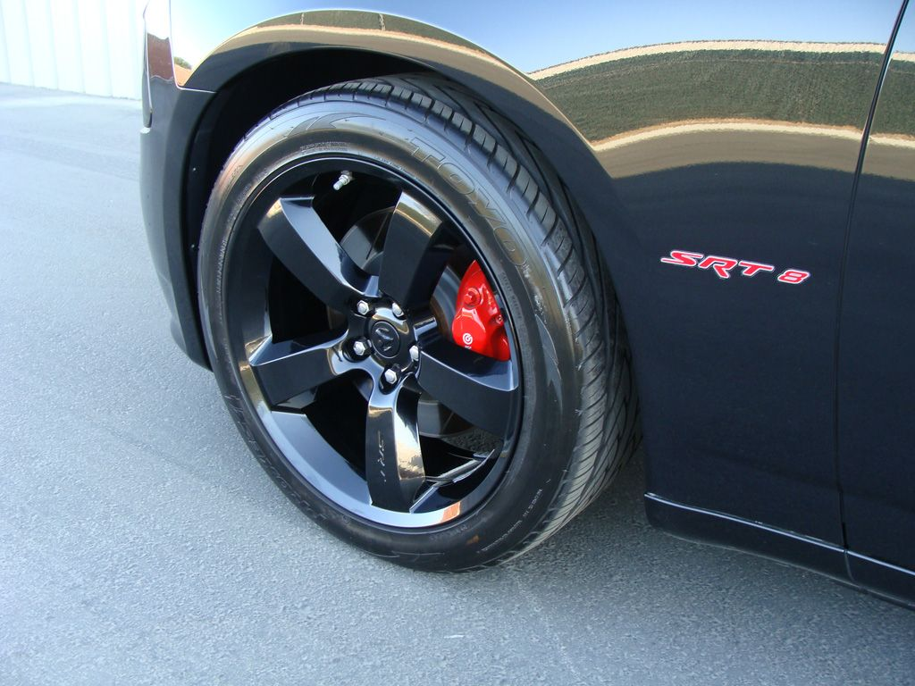 Dodge charger srt black chrome rims with red calipers