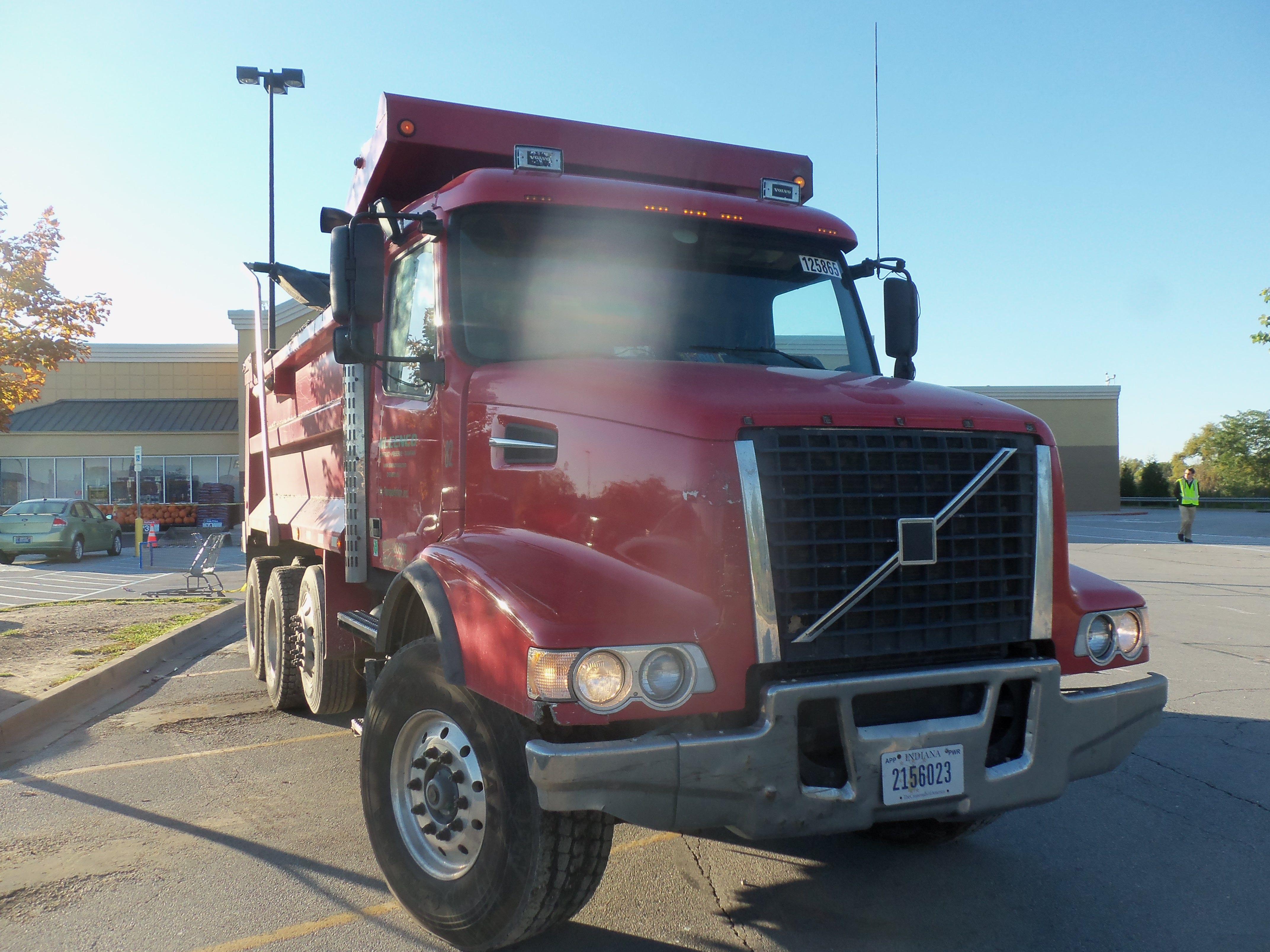 Red Volvo dump truck