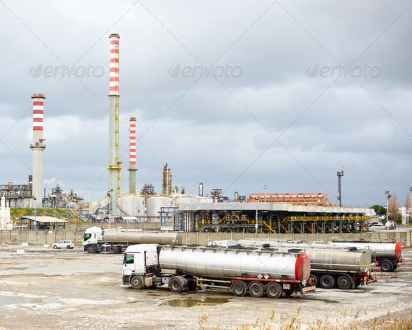 Oil refinery industry, smoke stacks and tanker lorry or truck by StevanZZ.  Oil refinery