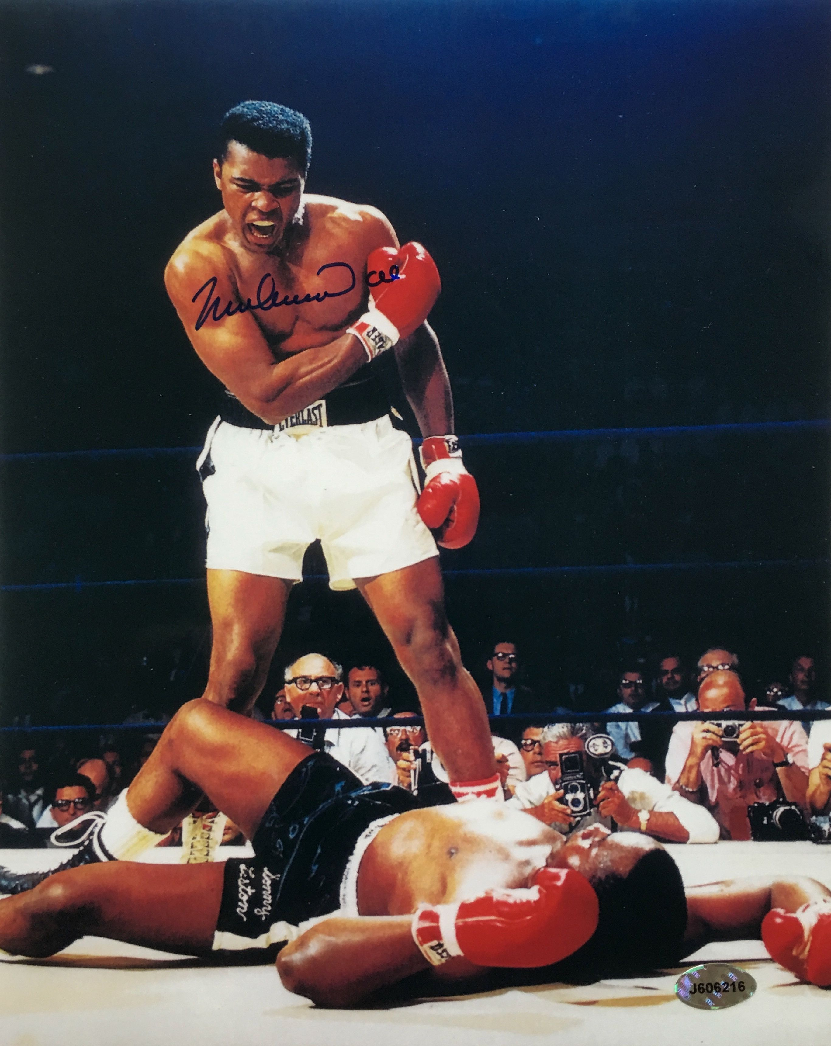 Beautifully hand signed 8x10 photo featuring the autograph of the legend muhammad ali this iconic photo is of ali standing over sonny liston after a