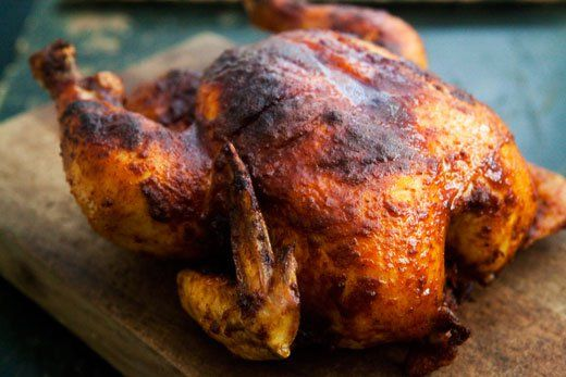 Whole chicken roast with a rub of smoked paprika, butter, garlic salt and pepper, and glazed with lemon juice and honey.
