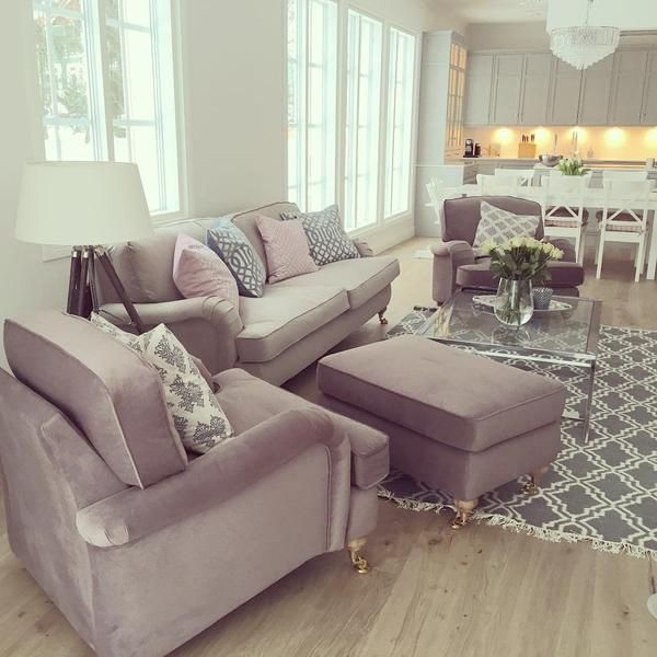 couch + two armchairs + ottoman in narrow living space. love this layout