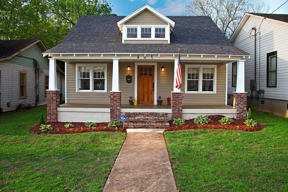Beige brick house exterior craftsman with red