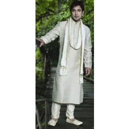 Off white brocade sherwani.