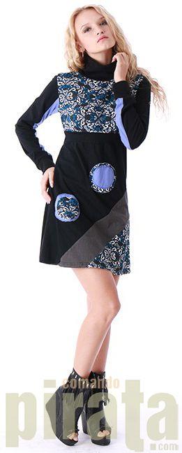 Vestido de invierno con el cuello tortuga. Magnífico modelo con flores retro impresas en el pecho, en la parte inferior de la falda y también en los parches del cuerpo. Color añadido haciendo contraste en mangas y parches. Este vestido hará que disfrutes de una moda diferente en estos días de invierno.