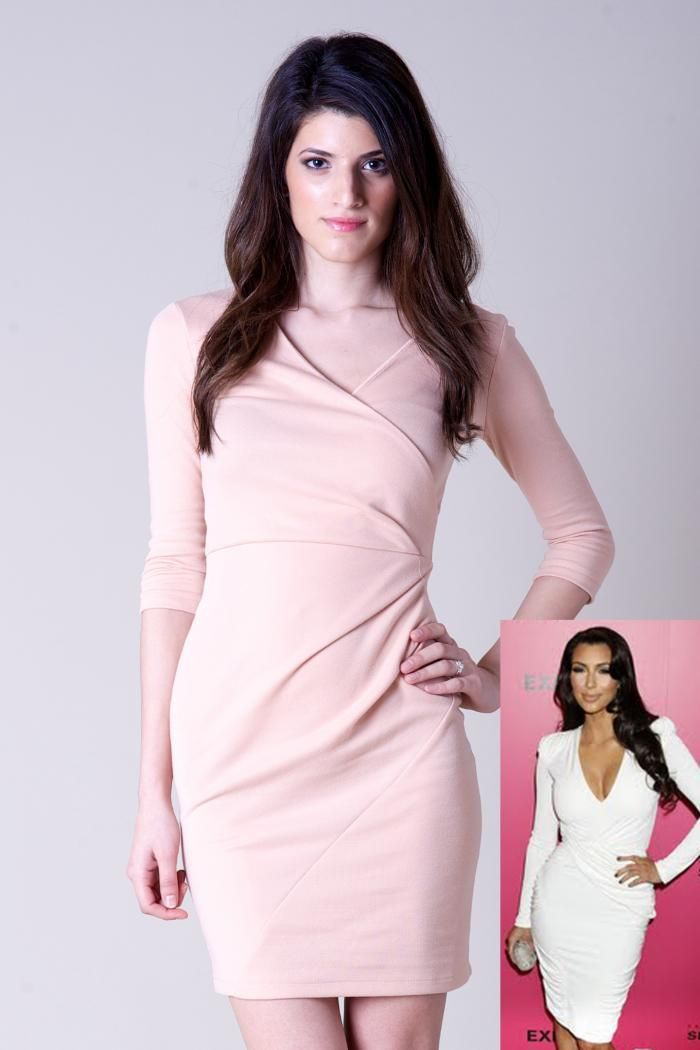 Designer look nude bodycon dress  Three-quarter length sleeves  Ruched around the waist  Zip at the back  Perfect dress for all occassions