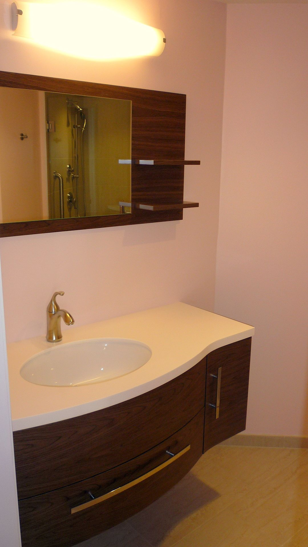 Light Coral Walls The Curvilinear Vanity Provides Great Storage For A Small Space
