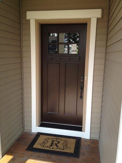 Beautiful Brown Door Dark Hardware And Black Door Step