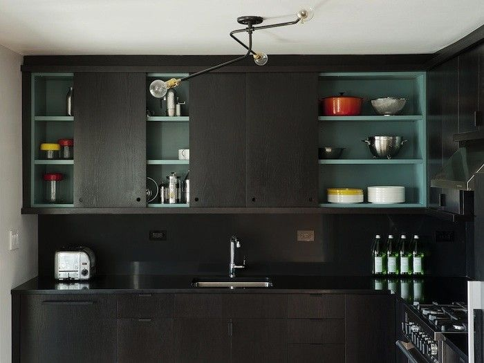 Black Kitchen with contrasting blue shelves by Workstead kitchens