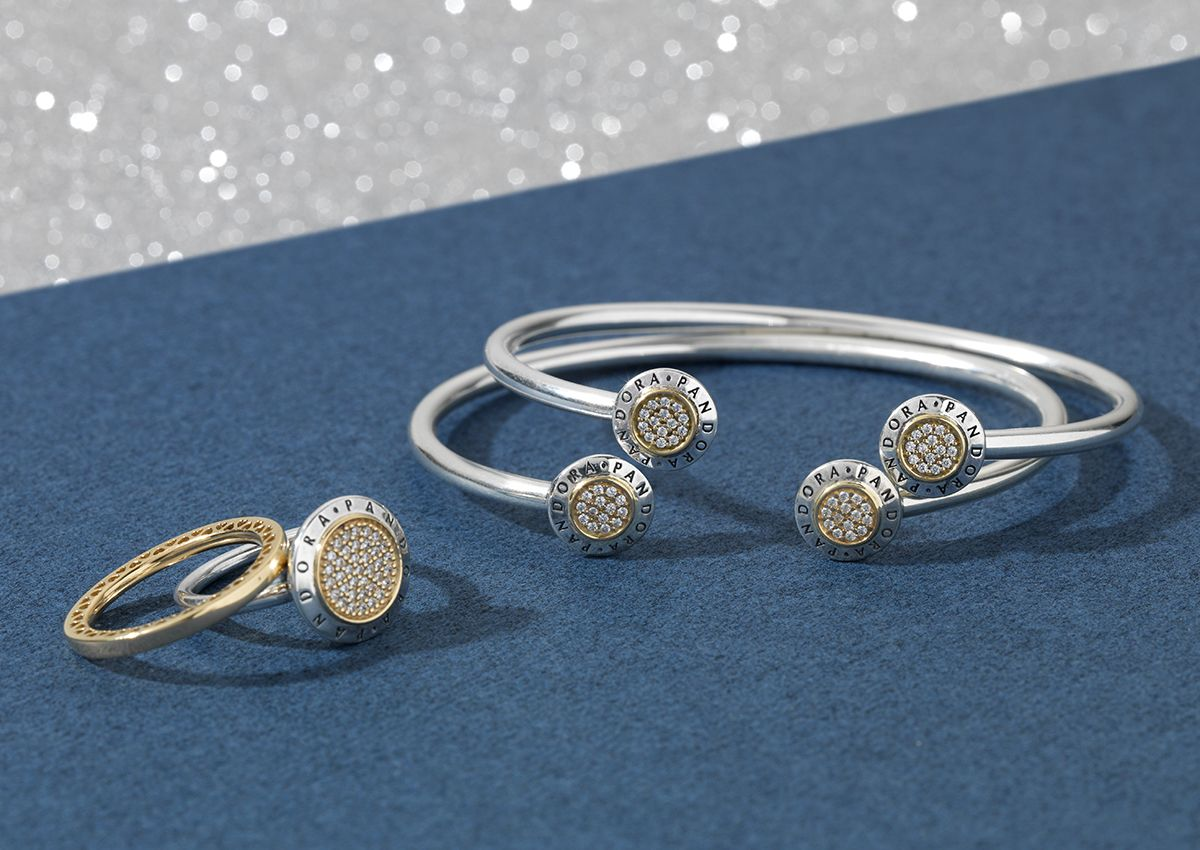 29c88820d PANDORA's signature bracelet and two-tone ring embellished with shimmering  stones are the perfect jewellery additions to your New Year's outfit.