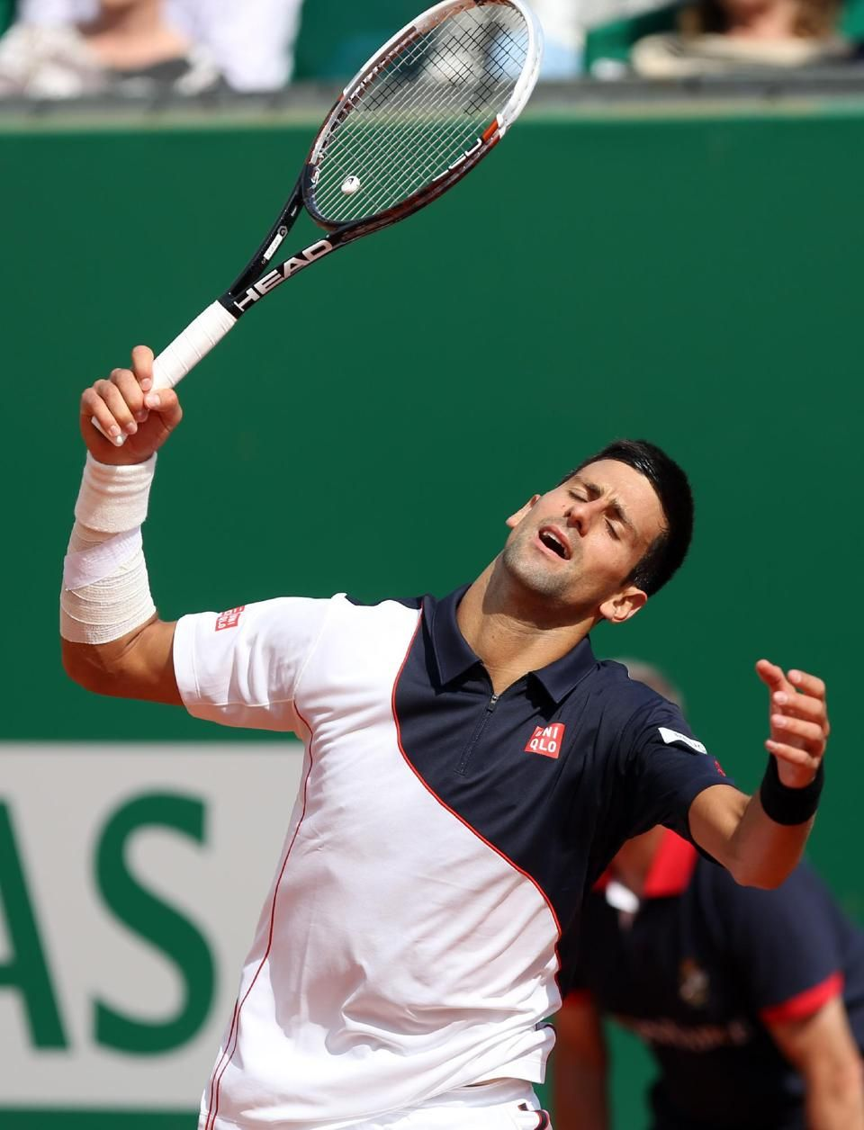 An Injured Novak Djokovic Reacts After Losing A Point Against Roger Federer During Their Semifinal Monte Carlo Tennis Masters Tournament Juan Martin Del Potro