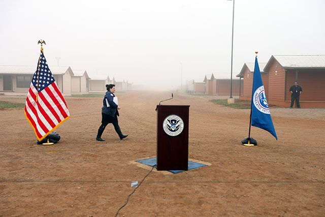 U.S. Immigration and Customs Enforcement public relations officials prepare for a visit by Secretary of Homeland Security Jeh Johnson at a new detention facility specially designed to imprison migrant women and their children as their deportation cases move through the courts, in Dilley, Texas, Dec. 15, 2014. (Jennifer Whitney / The New York Times)