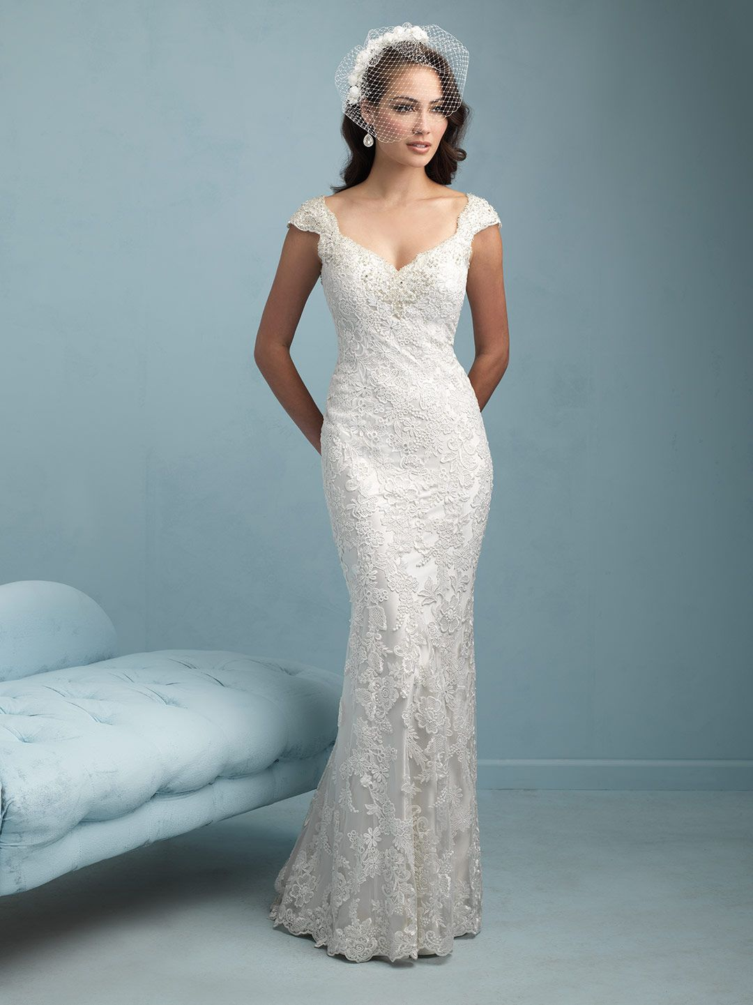 Allure 9212 This cap sleeved sheath splashes guipure lace across a ...