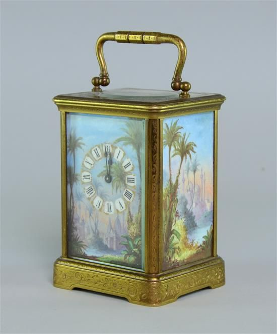 Nineteenth century brass glass and porcelain carriage clock three sides inset with porcelain plaques painted with exotic landscape scenes Sold for £850