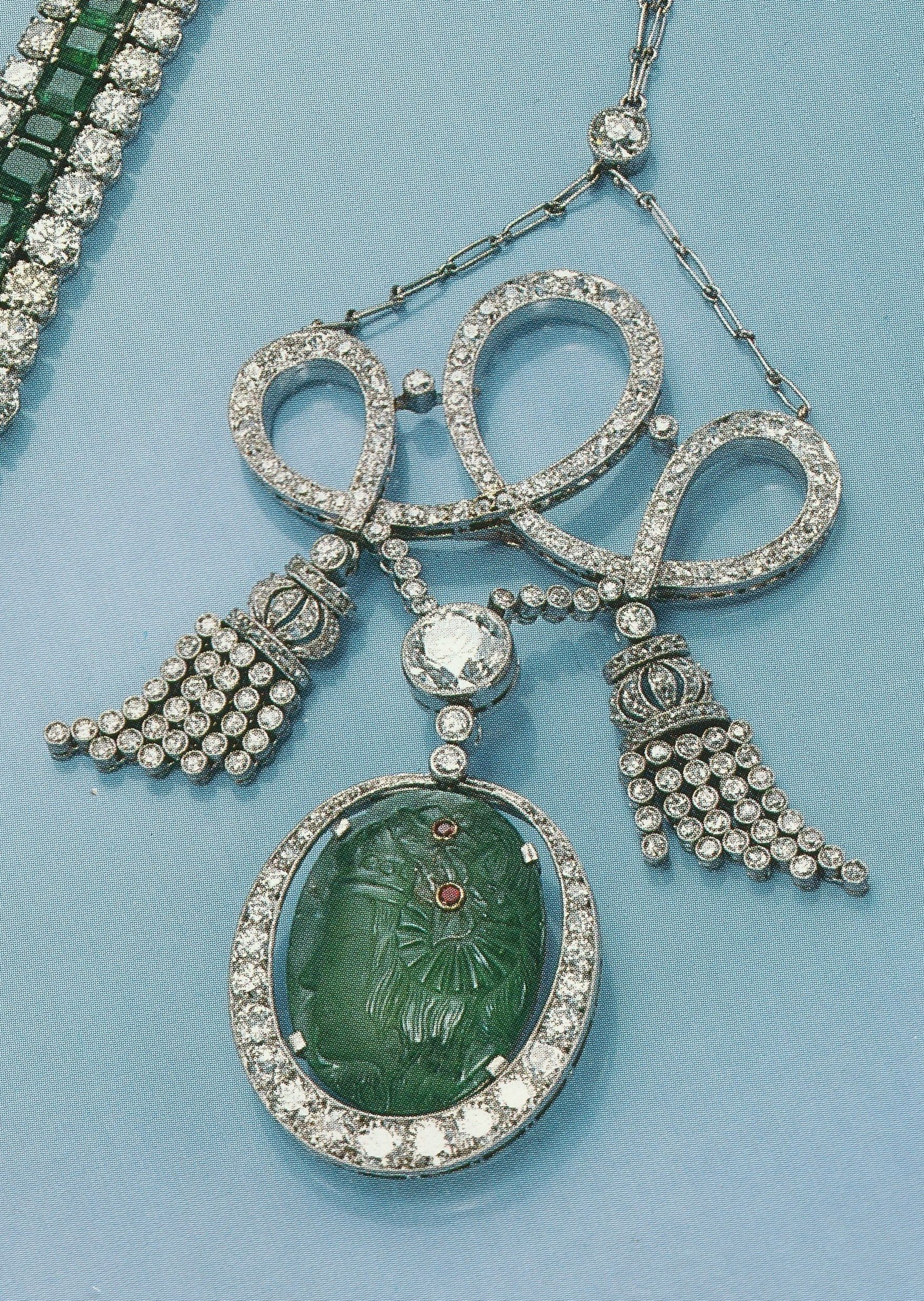 An art deco carved emerald and diamond necklace circa