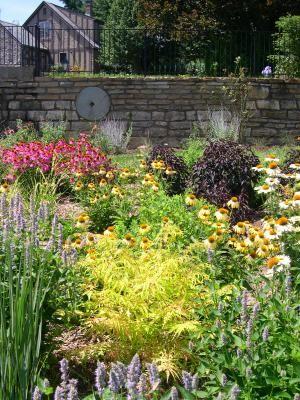 Garden Destination Louisville Kentucky The Bloom Garden Rock Wall Gardens Rock Wall Landscape Garden Landscape Design