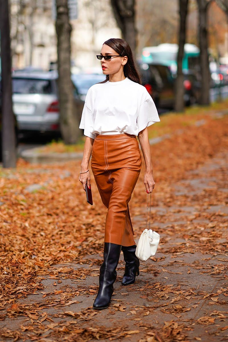 paris fashion week street style spring 2018 evangelie smyrniotaki white  shirt tan leather skirt black slouchy