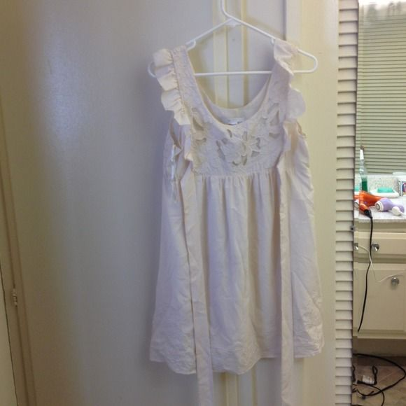 Ivory dress Sleeveless floral top on front and back. Floral detailing at bottom of dress as well. Tie waisted. Dresses