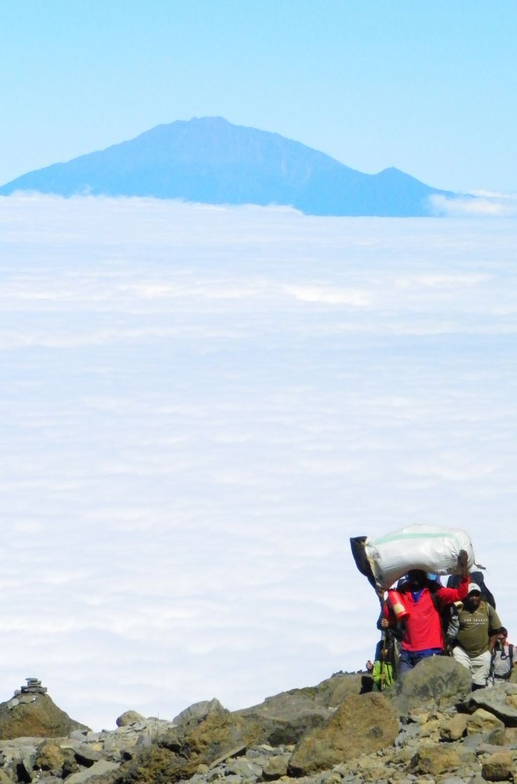 Hiking high above the clouds. At 5895 metres, Kilimanjaro in Tanzania is the highest peak in Africa and the highest free-standing mountain in the world. Click through for more info on the climb.