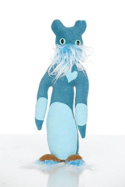 The extreme cold of the Antarctic caused a genetic mutation amongst the penguin population, and Gruffy was born. At least he has the best mustache on the continent. He is often grumpy because many things get stuck in his beard…    Handmade in the USA!