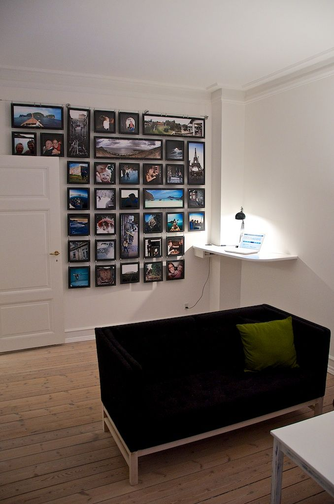 IKEA Hackers: Photo Wall Done Riktig. Curtain wire, clip hooks, s-hooks to  connect photos; photos are glued onto black matting.