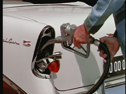 Gas station attendant filling up a 1956 Chevrolet Bel-Air