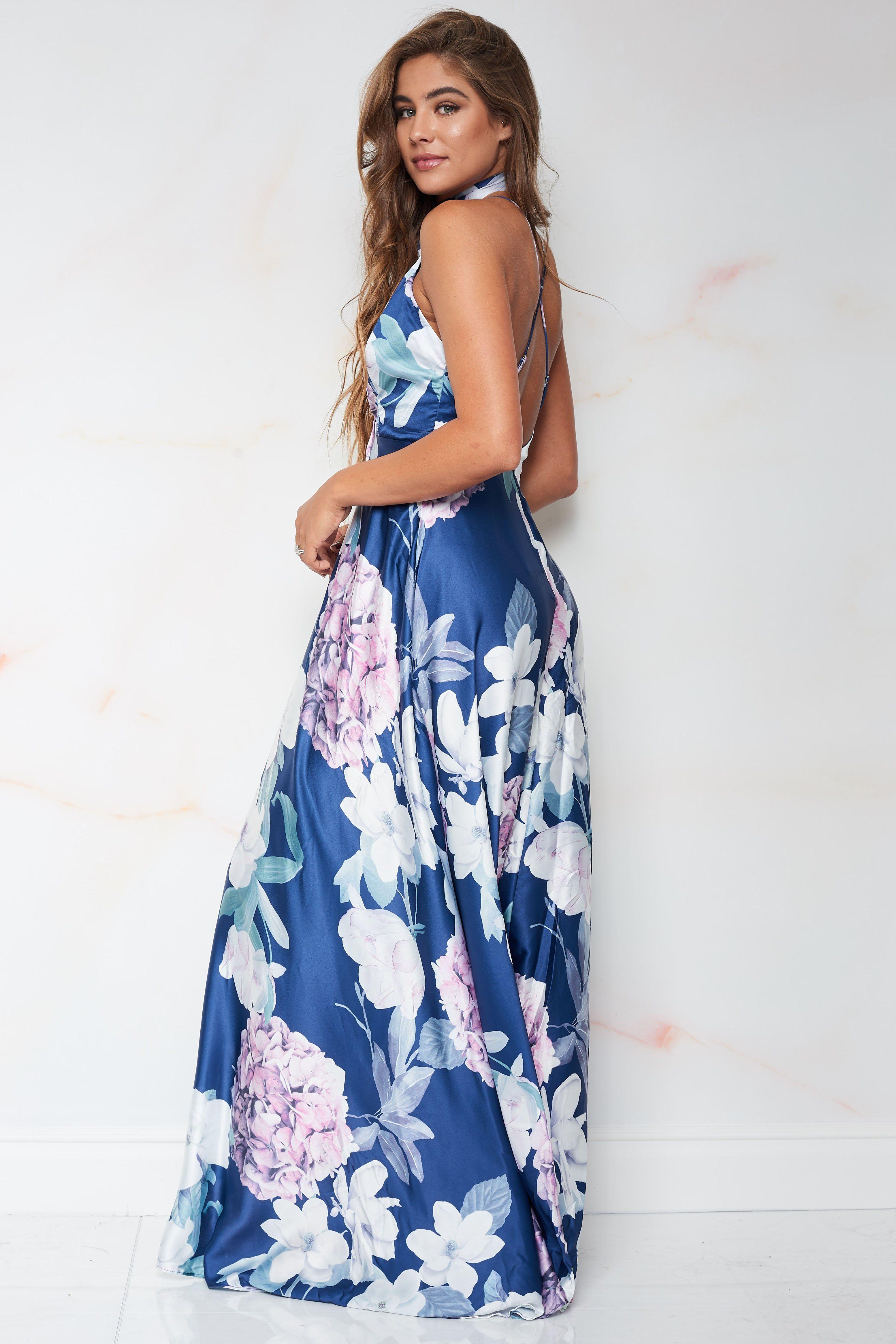 70ce8e90c22 A satin maxi dress featuring a beautiful floral print
