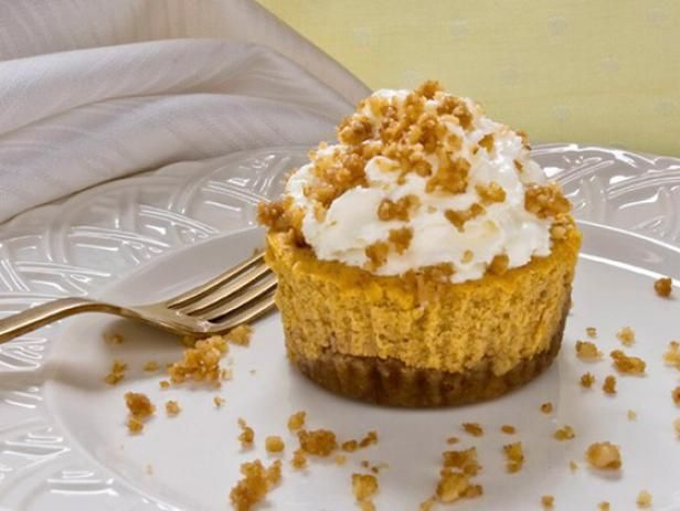 Get Walnut-Crusted Mini Pumpkin Cheesecakes Recipe from Food Network