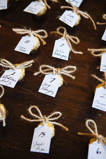 DIY wedding favors. Ferrero Rocher chocolates. Toothpick wrapped with jute rope holding attendees name & table number.  Attendees are able to use toothpick to eat chocolate too!  Claremont, CA wedding.  Photo from Lauren & Greg collection by Tammy Horton Photography