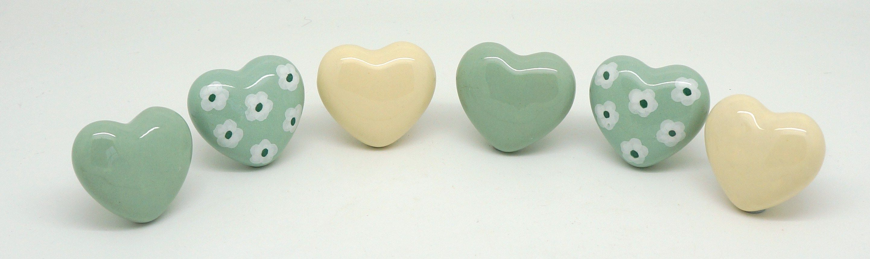 Heart shapes, cream and sage colours and original ditsy daisy designs.  Browse hundreds more at www.theseplease.co.uk