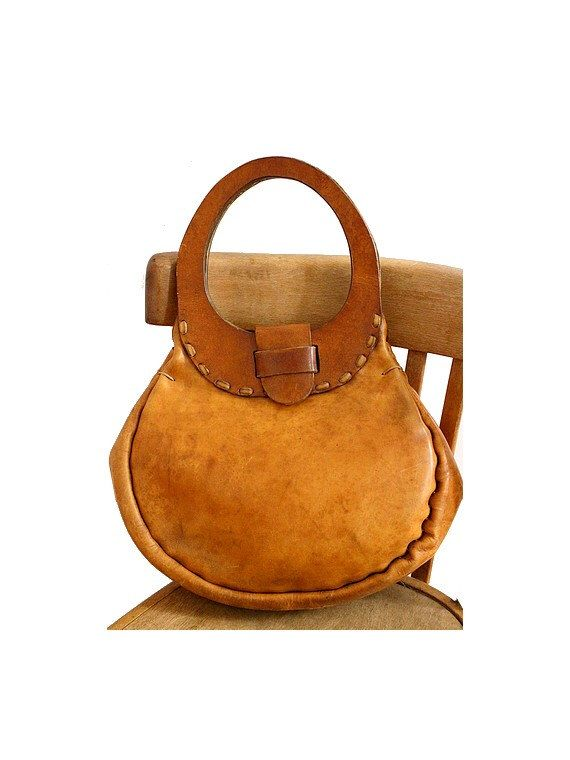 1970 tan leather BAG  round leather handle by lesclodettes on Etsy https://www.etsy.com/listing/235743148/1970-tan-leather-bag-round-leather