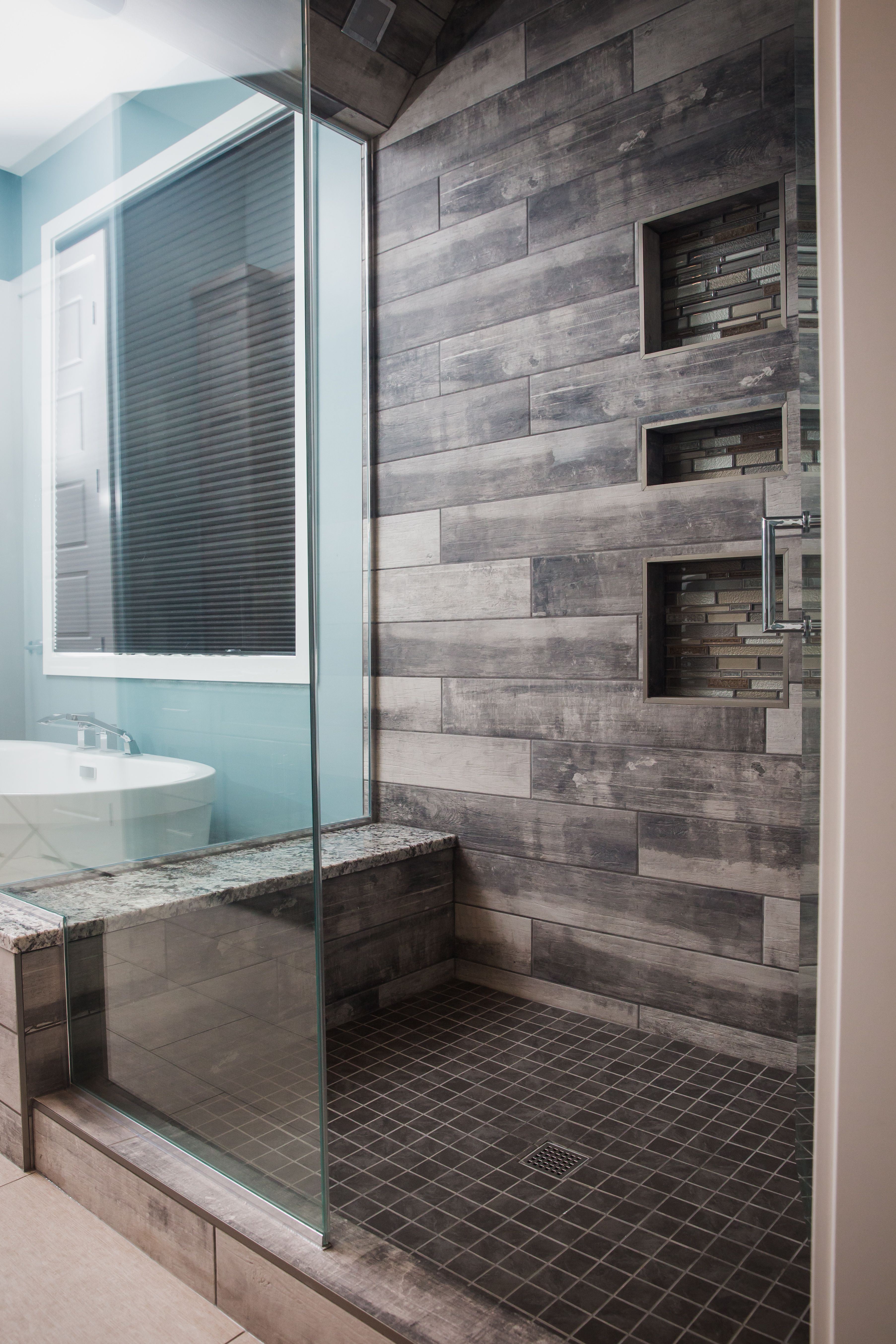 Amazing bathroom walk in shower featuring york wood manor tile color birch tree from dal granite bench with full enclosed glass walls home by neuhaven also contemporary boasts  gray subway tiled ceiling and