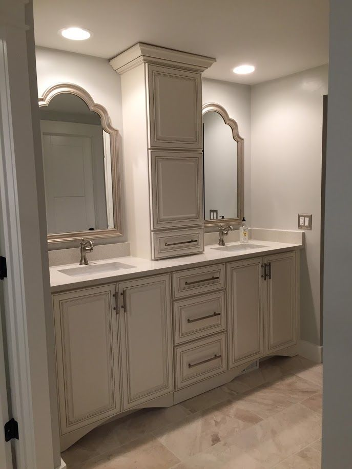 Double Bathroom Vanity With His And Hers Storage Tower And Arched