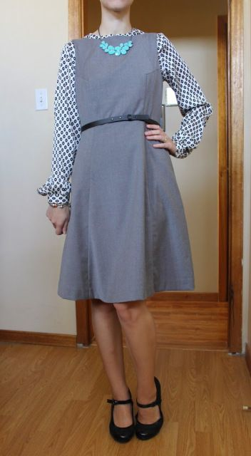 printed blouse, blue necklace, sleeveless grey dress