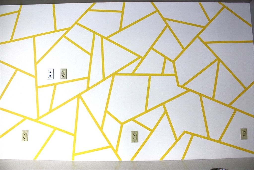 painting a design on a wall with worthy geometric triangle