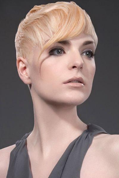 Feminine Blonde Pixie with Waved Bangs