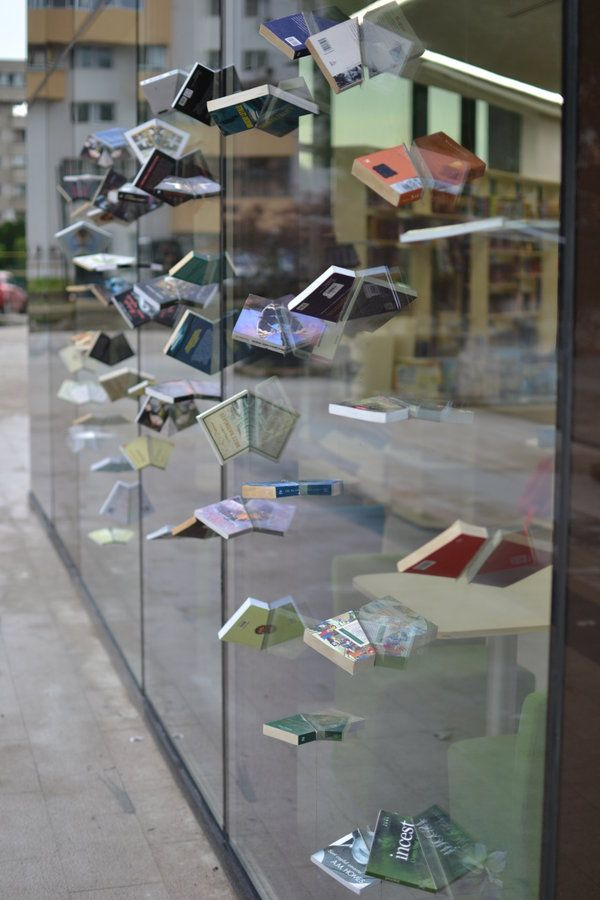Romanian storefront . . dramatic effect using books, a saw and a powerful…