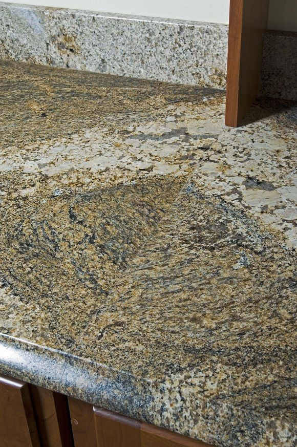 African Ivory Granite Countertop With A Bookmatched Seam Granite