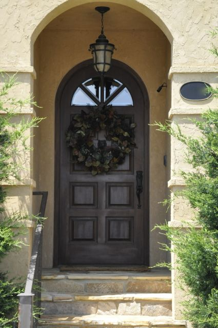 Spanish Style Front Entry With Arched Door