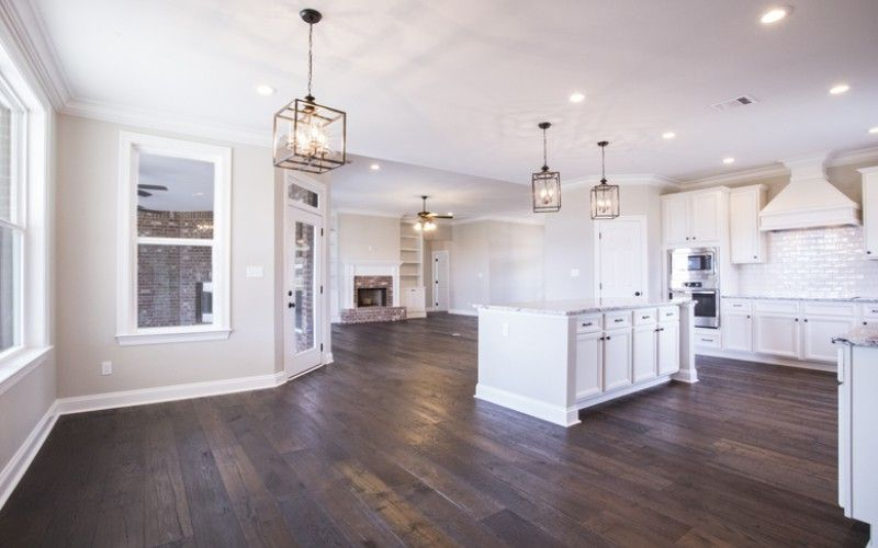 Open Concept Kitchen And Living With Dark Wood Floors And White Cabinets Townsend Homes Open Concept Kitchen French House Plans