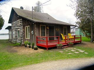 Charming 100yr. log home with upscale modern conveniences.