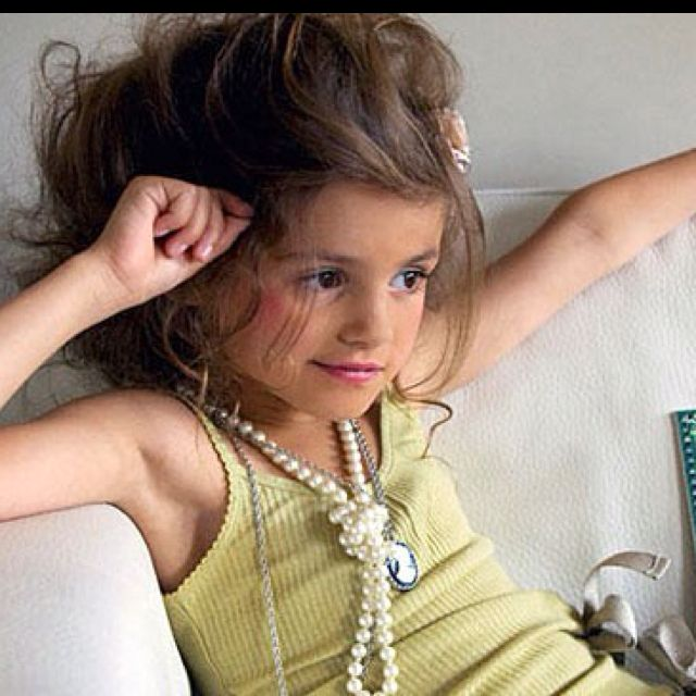 The future Vintage Jewelry Collector- this was a young me with the knot pearl look =)