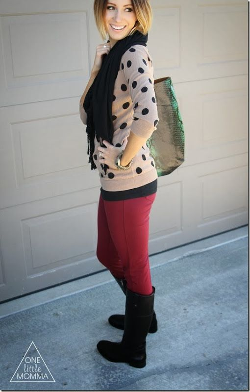Pair a polka dot sweater with burgundy pants and black riding boots.