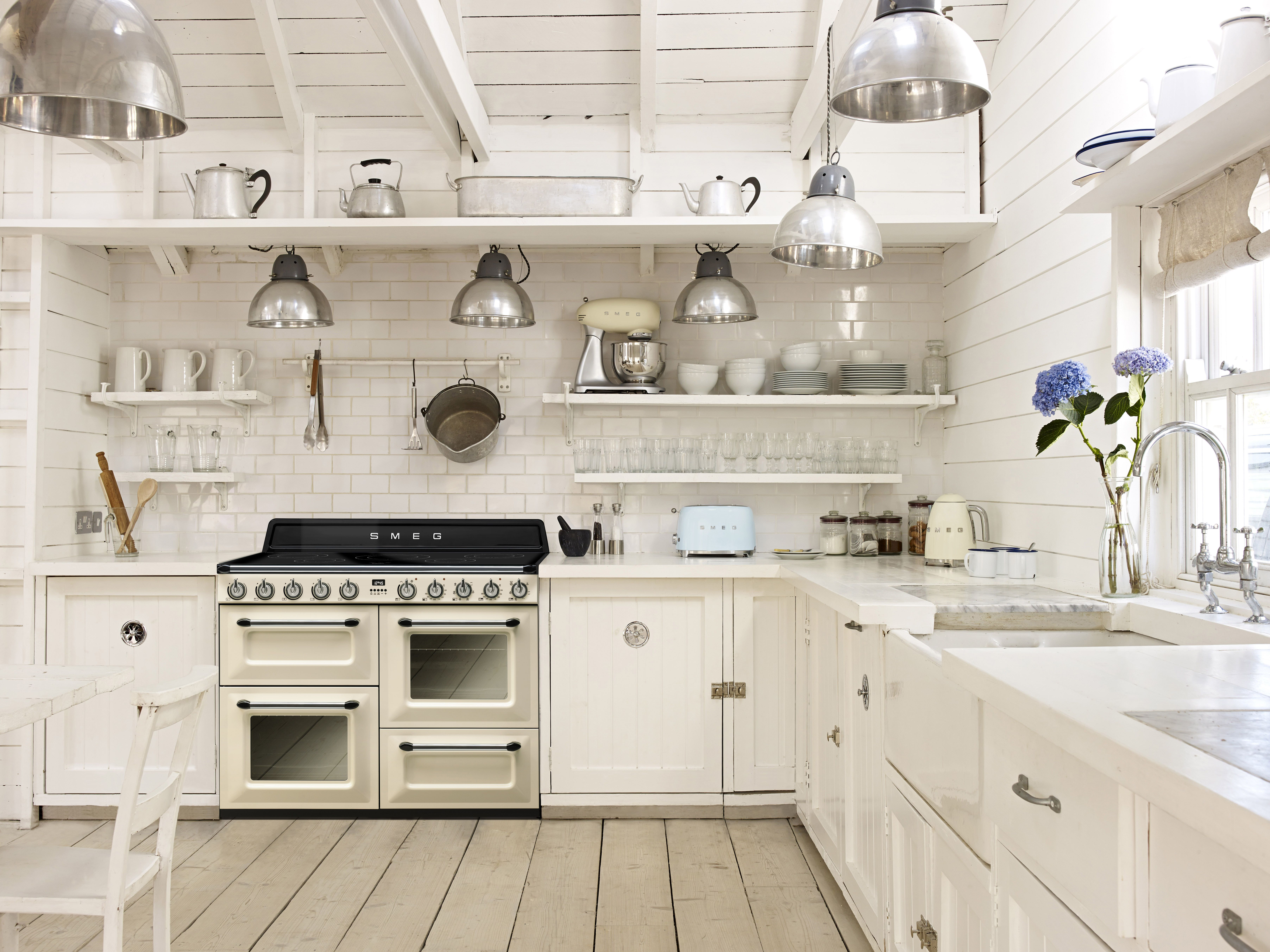 White country kitchen filled with Smeg small appliances